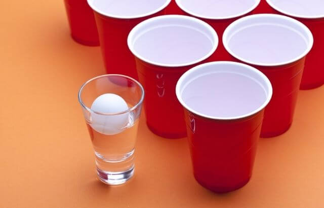 how to play beer pong without a table