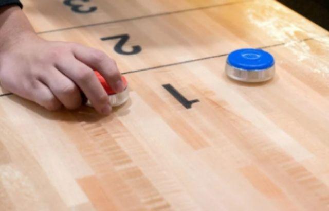 How Do You Hold a Shuffleboard Puck